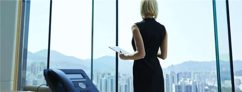 Business woman standing with tablet