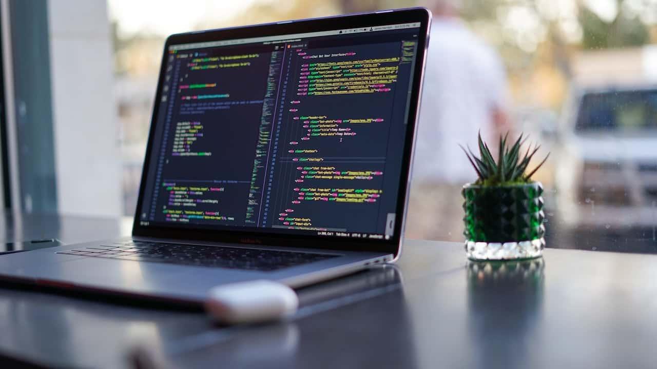 laptop on desk - SIEM as a Service